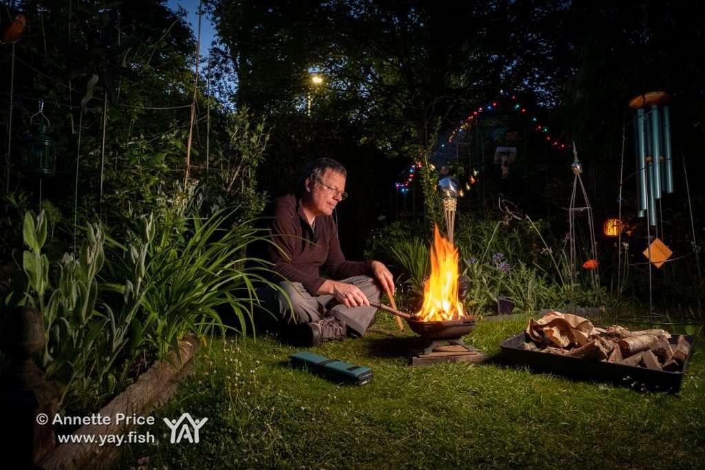 Tending the Garden Campfire.