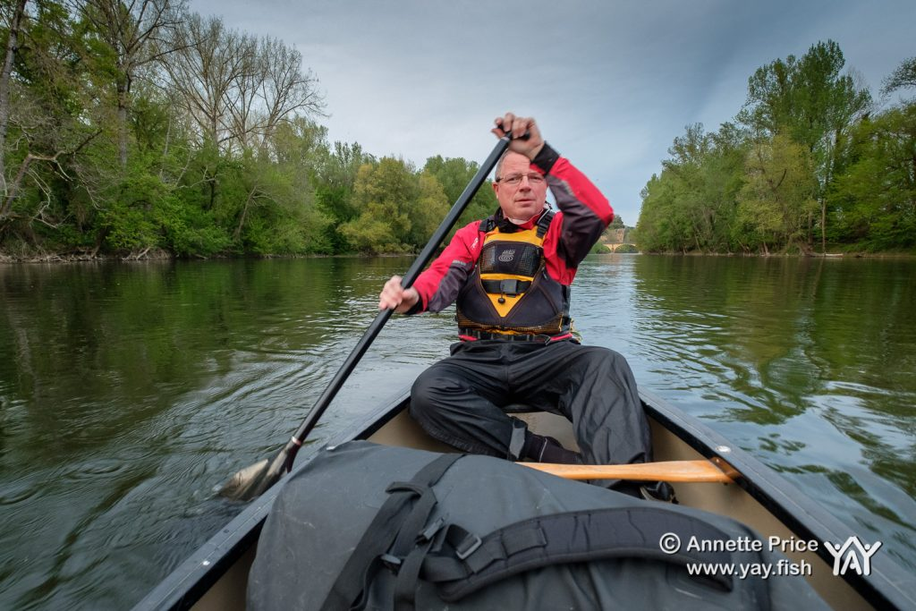 Canoeing on the River Dordogne, before setting up to wild camp for the night. France.