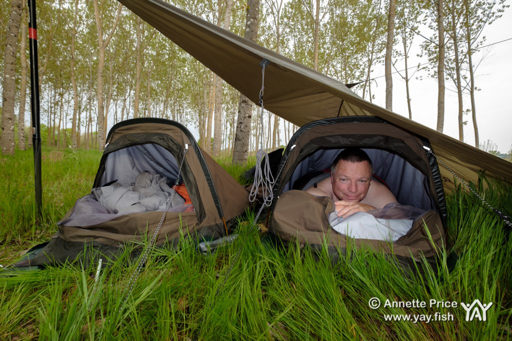 Wild camping along the river bank. River Dordogne, France.